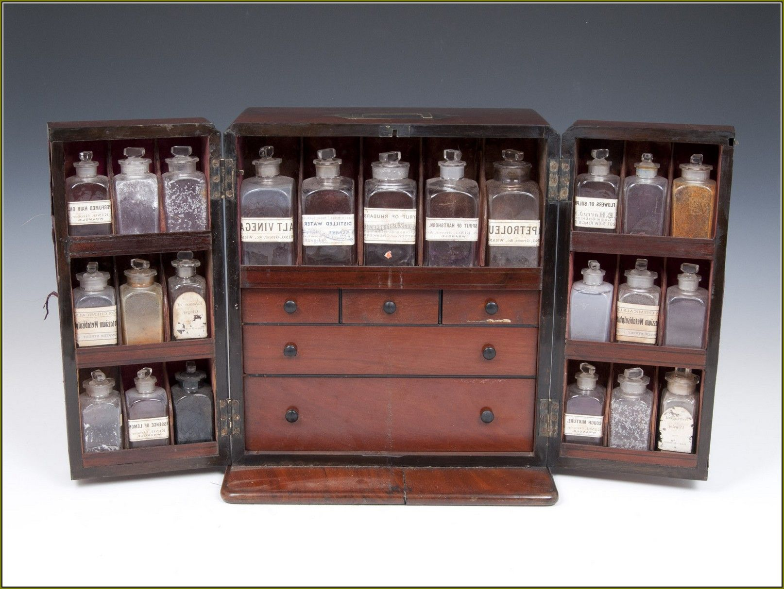 Bon Antique Three Column Apothecary Cabinet With Glass Jars And Brown Drawer As  Classic Cabinet Storage Pictures