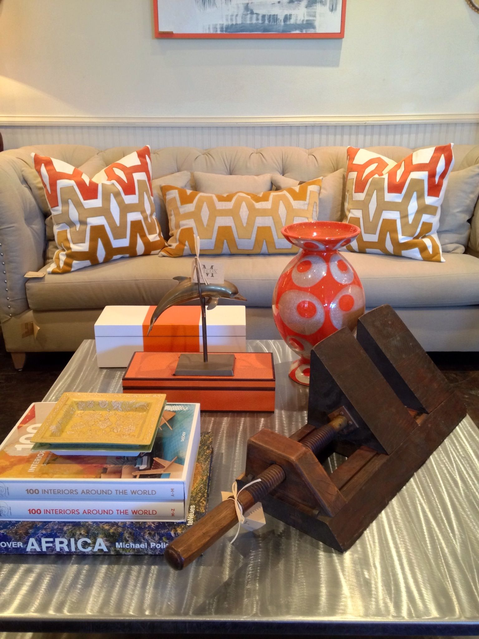 Neutral sofa palette with #coral accents and #vintage #wood #vice at #Dallas #Mecox #interiordesign #MecoxGardens #furniture #shopping #home #decor #design #room #designidea #antiques #garden