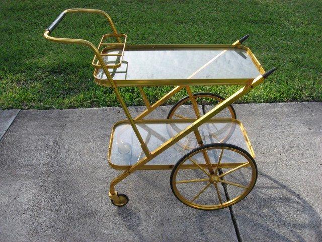 Retro Midcentury Modern Anodized Aluminum Bar Cart Retro Made in Peru 1960s. $300.00, via Etsy.