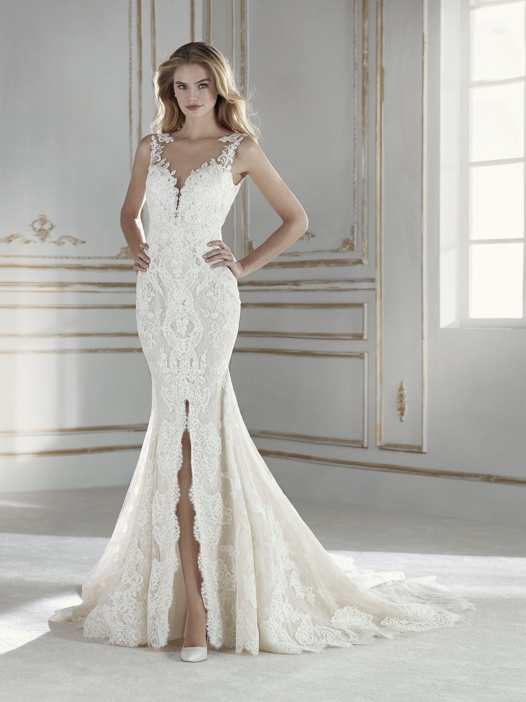 LA SPOSA 2018 Style PARIS Mermaid dress in lace and embroidered Tulle with  beaded appliqués. The gown has a deep center slit in the skirt and a V-neck  front ... e0bce9b7930