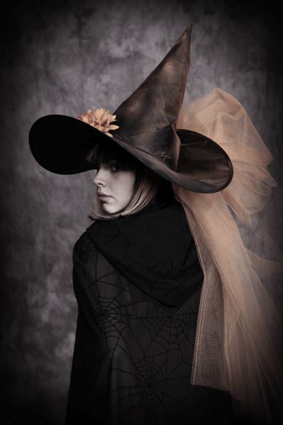 Real witches don't wear pointy hats, but I guess she does...lol