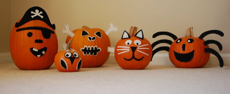 Use self adhesive felt to decorate pumpkins for halloween, then - halloween pumpkin decorations