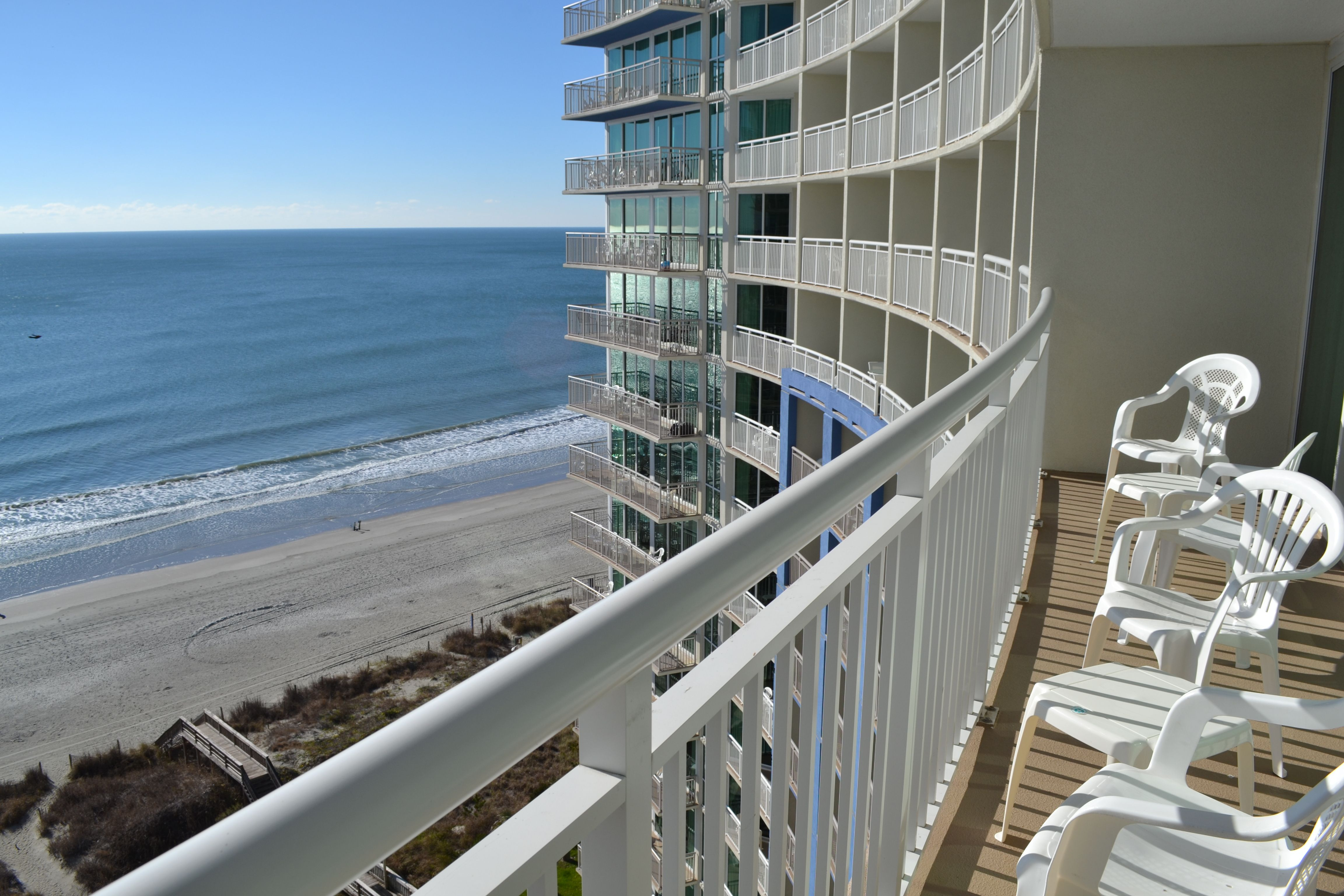 Enjoy your own private balcony overlooking the ocean at