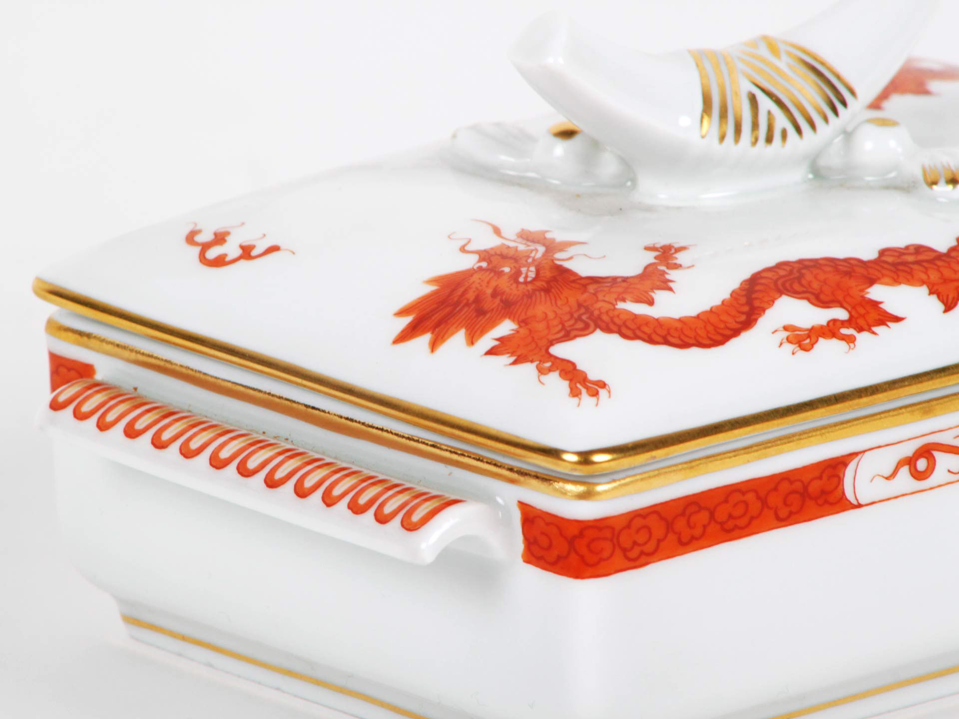 Meissen hand-painted porcelain case box red dragon model with orange tones decoration and gilded edge. Signed with the two swords of the Meissen factory. Germany. #Meissen #Porcelain #HandPainted #Red #dragon #decoration #TwoSwords #stamp #Germany #design #BellamysWorld