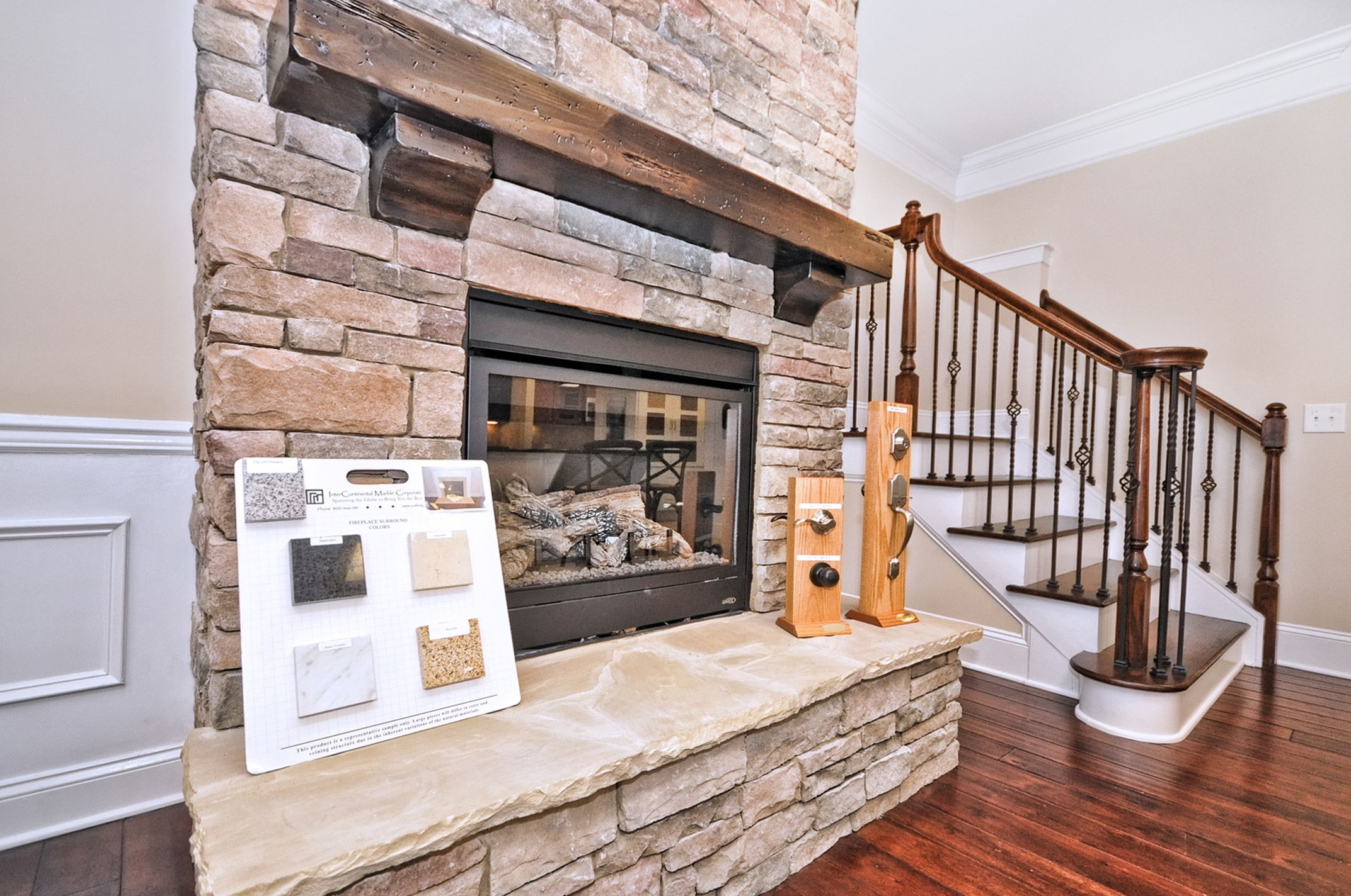 Essex Homes Charlotte Design Studio - Stone Fireplace & Stair ...
