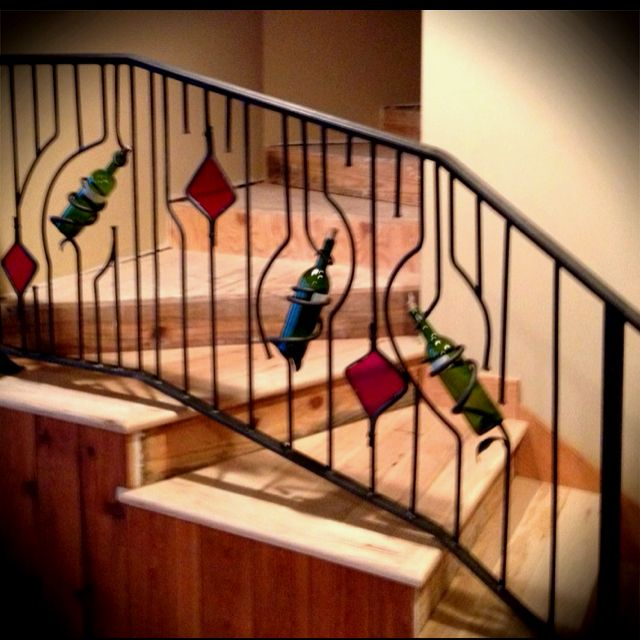 Wrought Iron Railing With Wine Bottles And Stained Glass