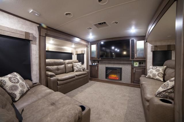 Open Range Front Living Room 4 Season Fifth Wheel. This Front Living Room  Has Entertainment Center On Front Wall With Storage On Each Side Of TV, ...