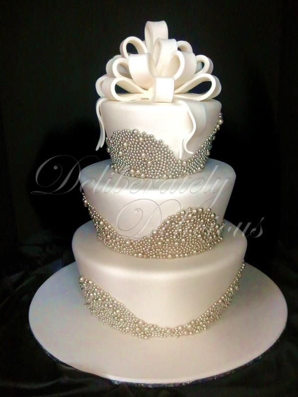 Love the shape of the tears and the edible pearls but not the bow on top. Definitely want simple and elegant.