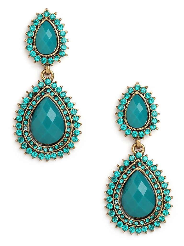 This one's a stunner you're going to love. There are two dazzling faceted gems, in elegant teardrop shapes, and each comes framed in even more glittering finery.
