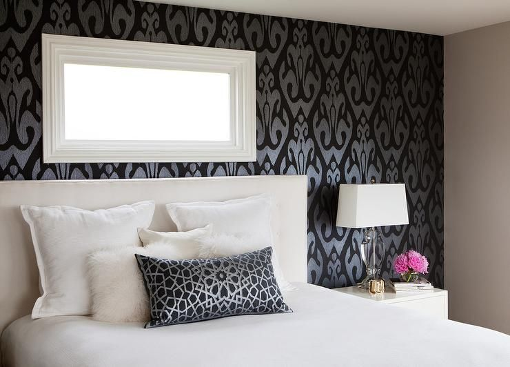 Sophisticated Bedroom Features An Accent Wall Clad In Black And Silver Ikat  Wallpaper Framing A Narrow