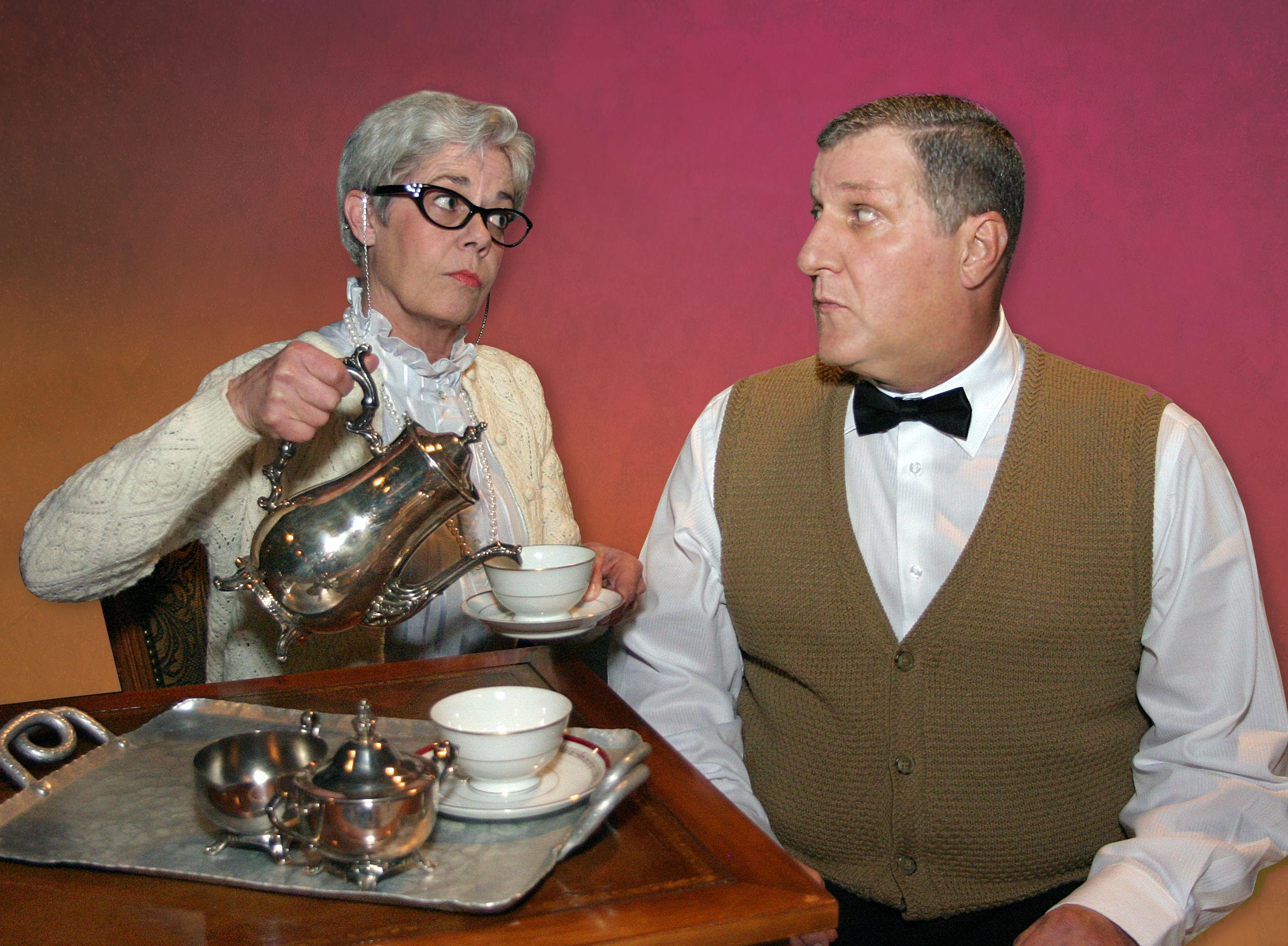 Mrs. Mannerly (Linda Abronski) takes on a new student in her etiquette class, young Master Jeffrey (Stephen F. Vrtol III).