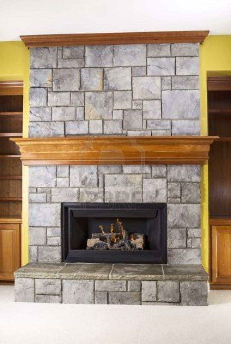 stacked stone with wraparound mantle and crown molding Fireplace