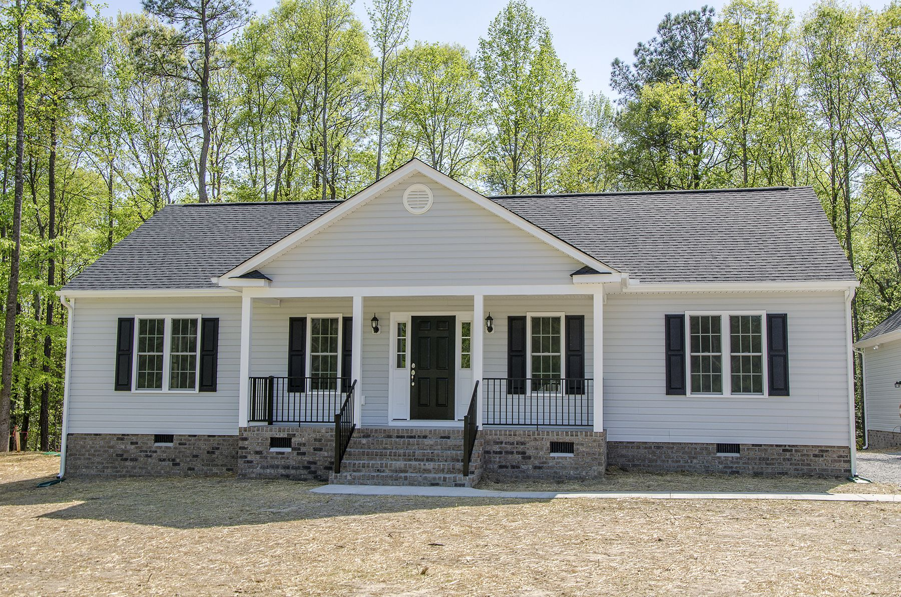 Beautiful Ranch Style Custom Home With A Front Porch And A Roof