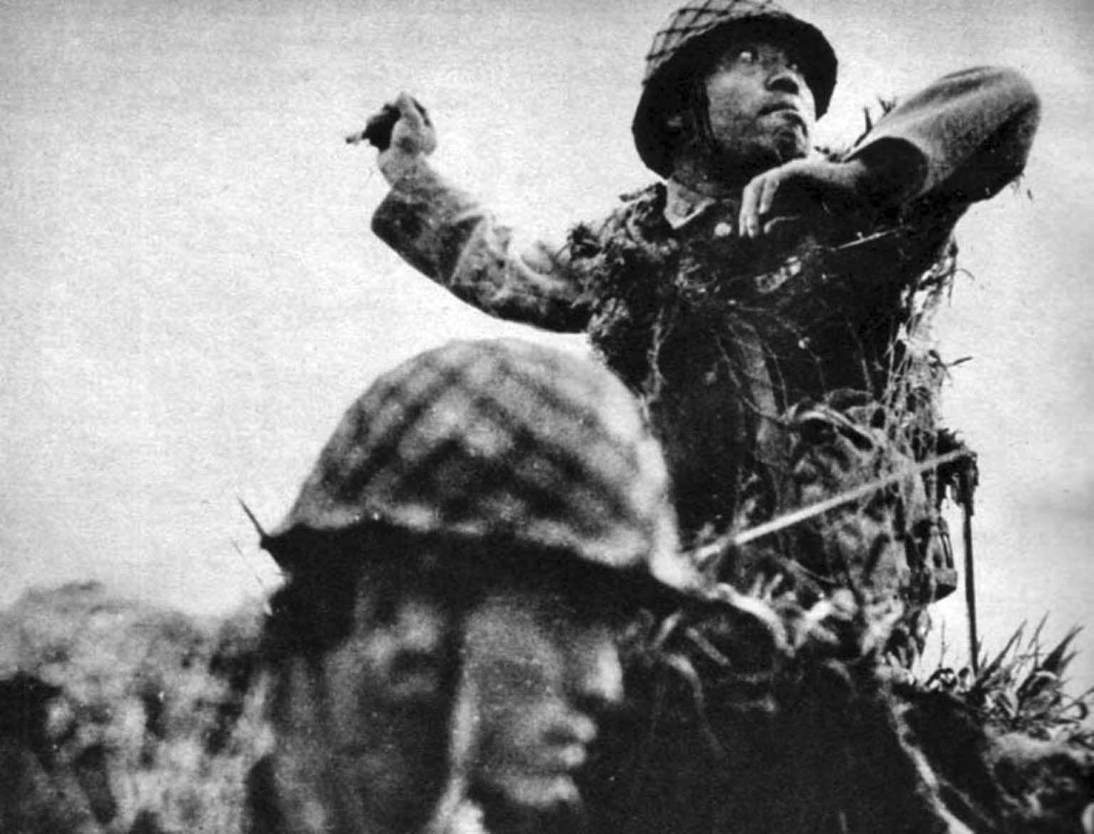 Japanese soldier throws a hand grenade in the Battle for Guadalcanal