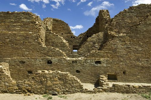 """Pueblo ruins at Chaco Culture National Historical Park. - Kin Kletso (""""Yellow House"""") was a medium-sized complex located 0.5 miles  west of Pueblo Bonito. It contains 55 rooms, four ground-floor kivas, and a two-story cylindrical tower that may have functioned as a kiva or religious center. The village was erected between AD 1125 and 1130."""