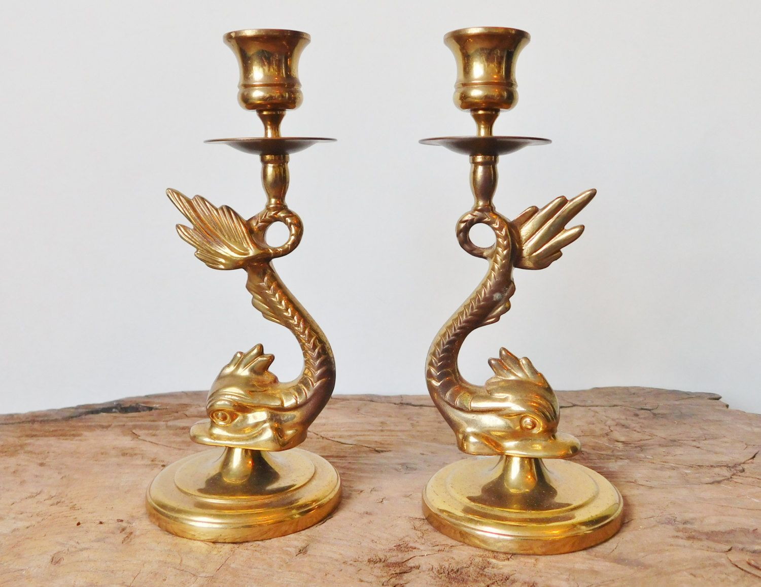 brass sea serpent candlestick holders matching pair brass sea brass sea serpent candlestick holders matching pair brass sea dragons sea creature mythical dragon mid century asian vintage
