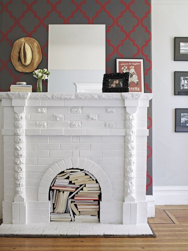 pictures framing the fireplace, and vespa sign Tempaper Covered ...