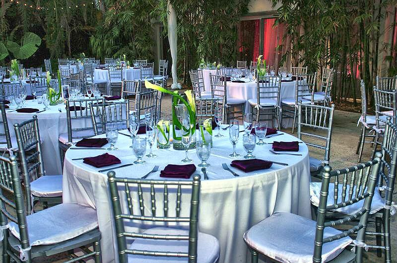 Table Setting With Silver Chiavari Chairs White Satin Linens And White Callalilies Yourmiamiwedding Catering Design Event Catering Table Settings