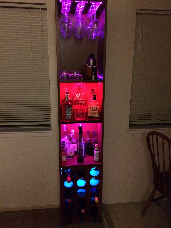this is my custom ikea liquor cabinet that i added lots of hidden rgb leds an arduino mega an ultrasonic range sensor and ir remote to