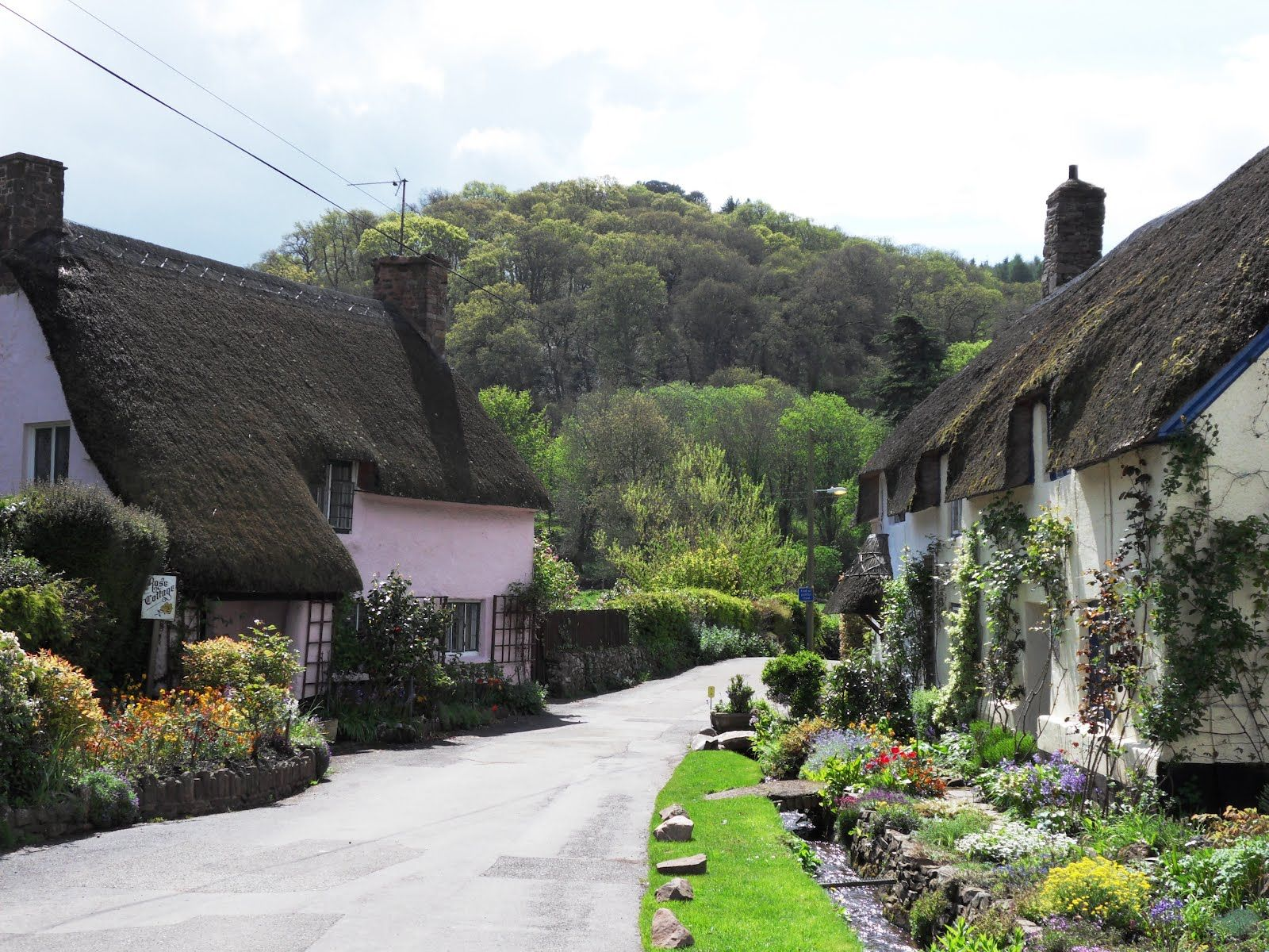 The Village Of Dunster In Somerset England Basks In The