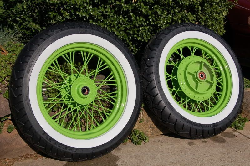 painted spoked rims with white wall tires