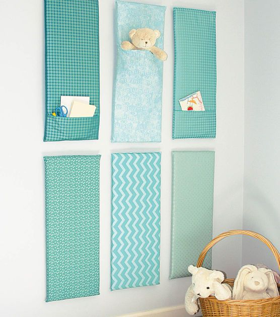 Fabric panels create a soft touch for wall decor!  Add pockets for storage or to display your favorite items!