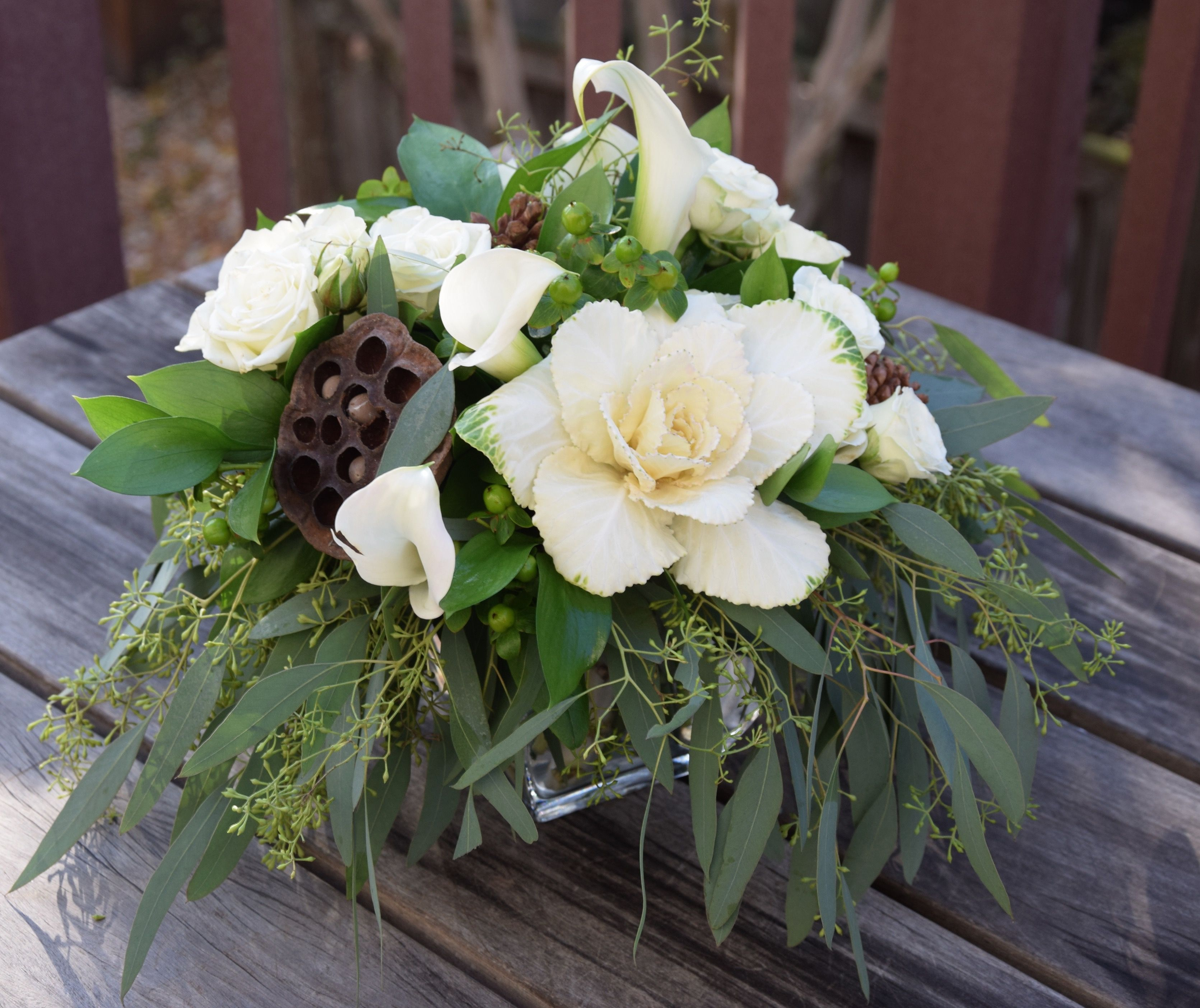 Flower Arrangement With White And Green Fresh Flowers Pine Cones