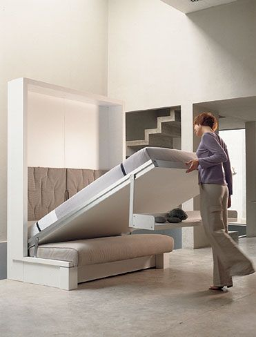 Wall bed... want mine!! I wouldn't have to clean under my