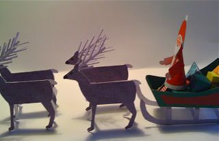 Santa Claus with sleigh and reindeers