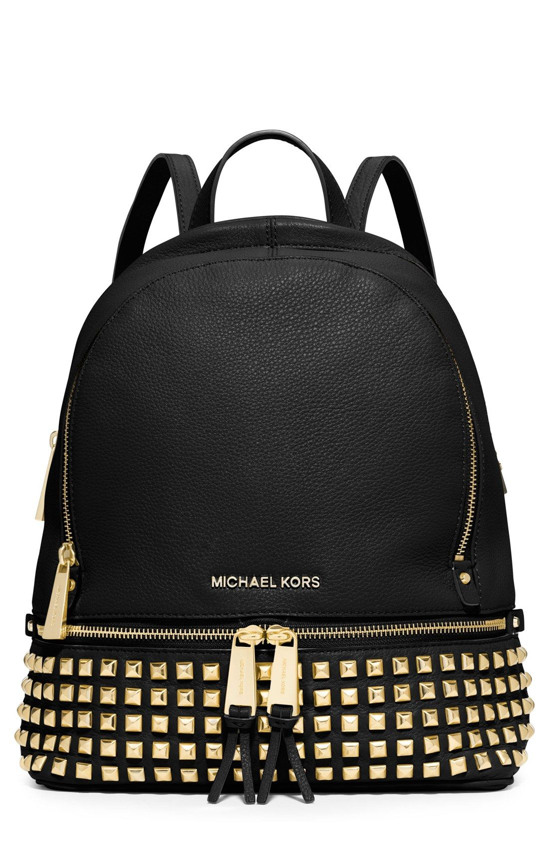 512e1bcd580e8d Rows of gold pyramid studs and tasseled zippers give this Michael Kors  backpack a city chic edge.