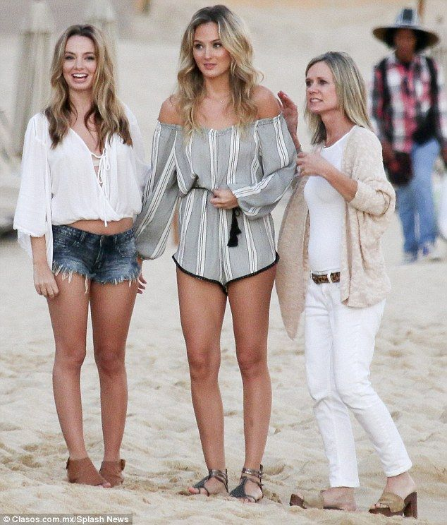 84cf93bc5bed4 Life s a beach  Lauren (C) arrived at the beach in a cute off-the-shoulder  grey and white .