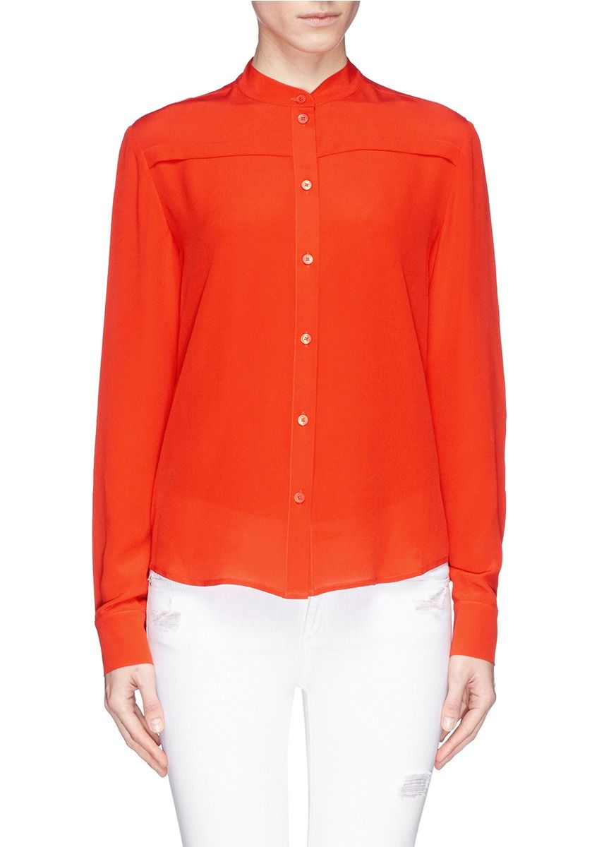 Fiery red with an orange undertone, this shirt from McQ Alexander McQueen is a sophisticated way to elevate a wardrobe staple. This piece makes a simple statement with the covered yoke seams and flatteringly straight cut design with a versatile rounded hem.