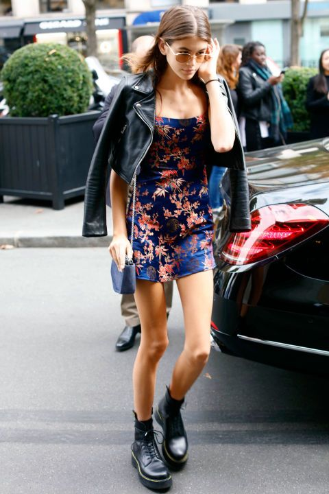 519593afa50e15 25 September Kaia Gerber paired a Reálisation Par dress with a biker jacket  and Dr Marten boots while in Paris.