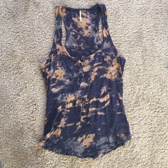 Free People tank top Cute, long, button up genuine Free People tank top. I love this tank but it never gets worn. It's probably been worn twice. Needs new home who will love it! Size medium. Free People Tops Tank Tops