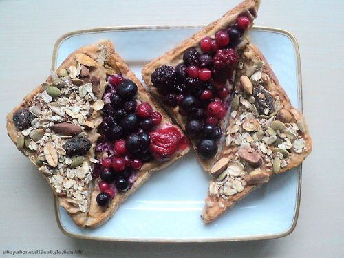 2 slices toasted ww bread topped with pb,warm berries and granola #healthy #food