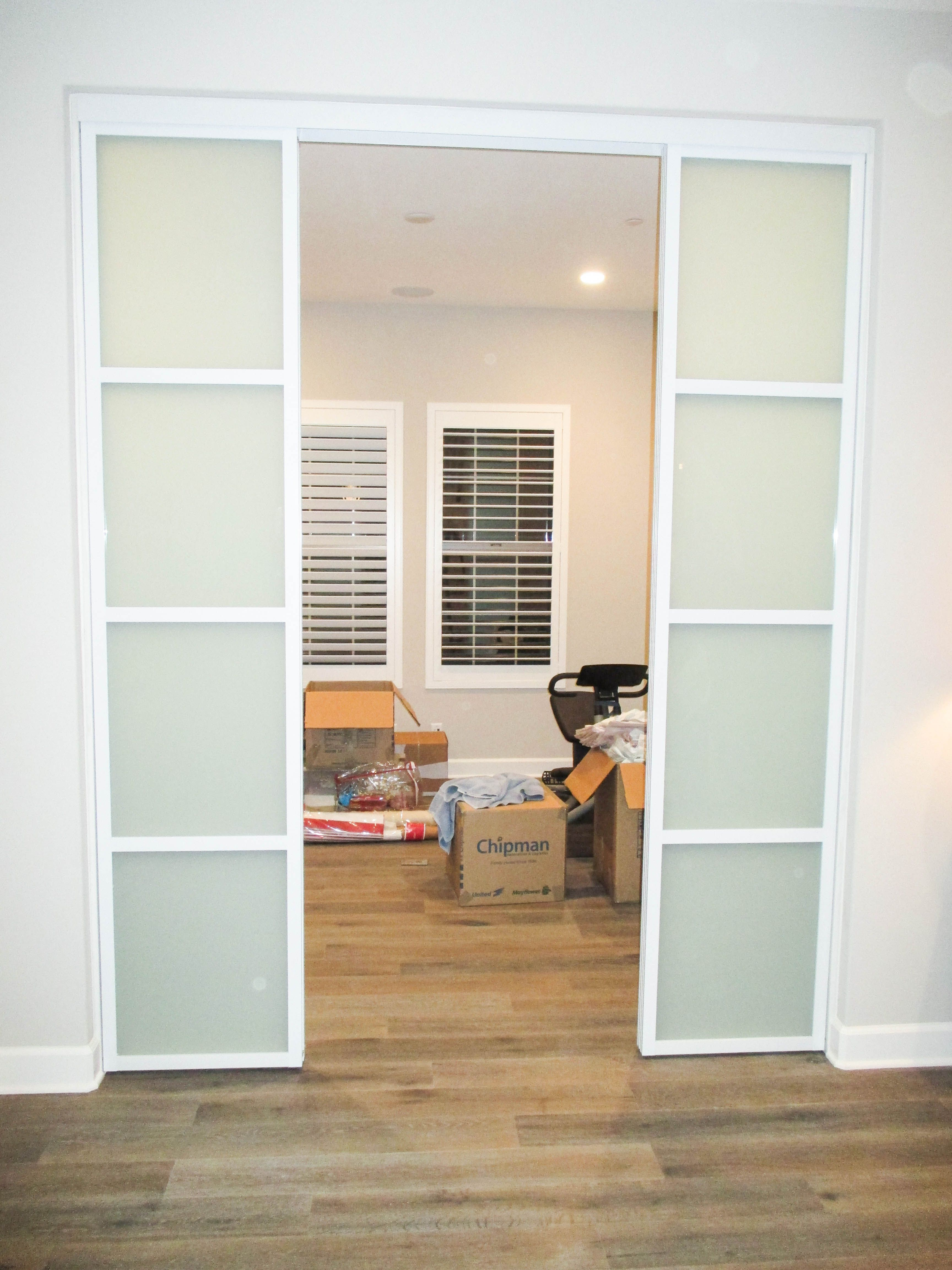Our team installed this 4-panel, 2-track top-hung Aluminum Frame ...