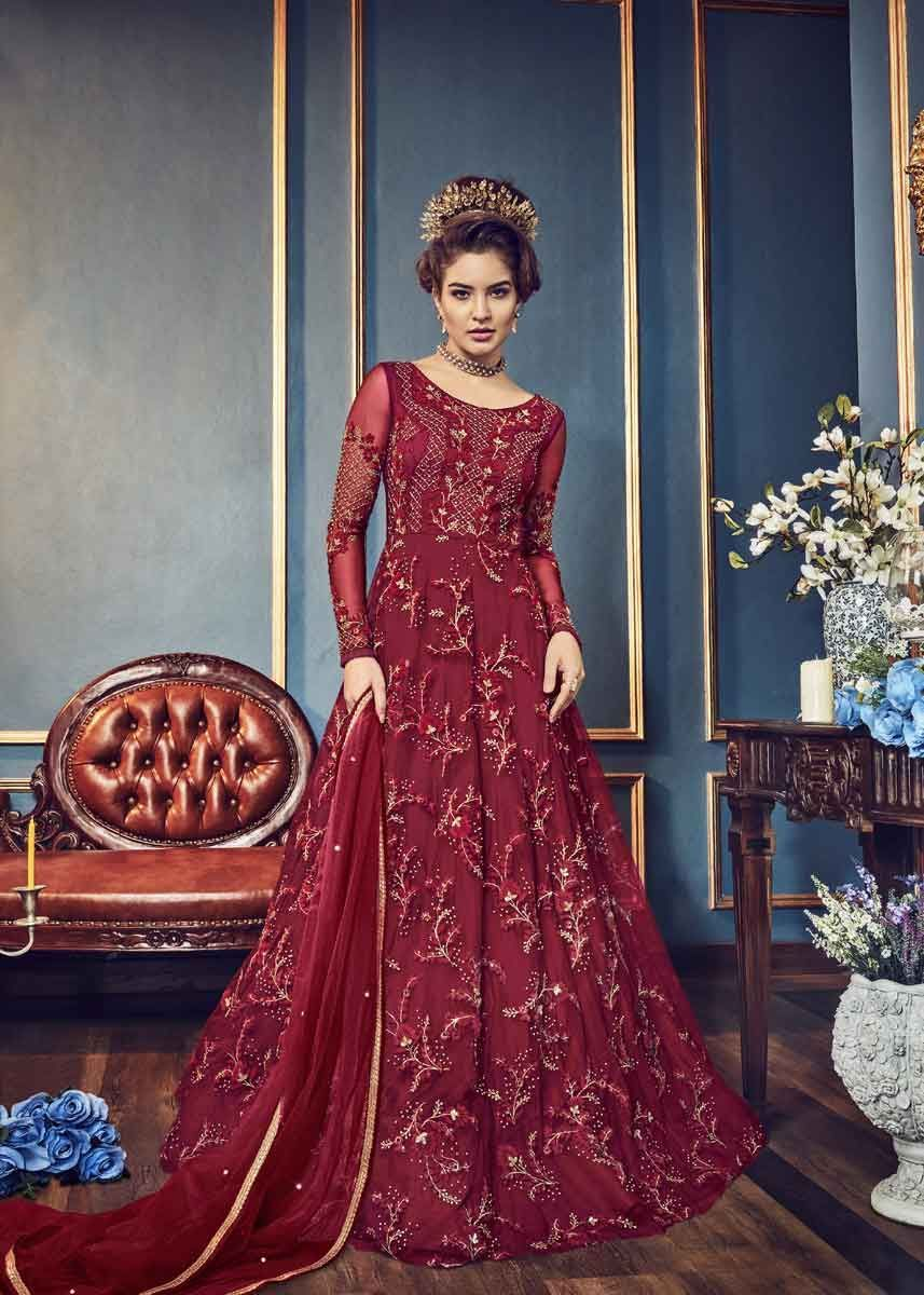 90e62c50ec Showcase pure traditional elegance at the next gala wearing this  magnificent maroon color butterfly net heavy embroidered wedding wear  anarkali suit.