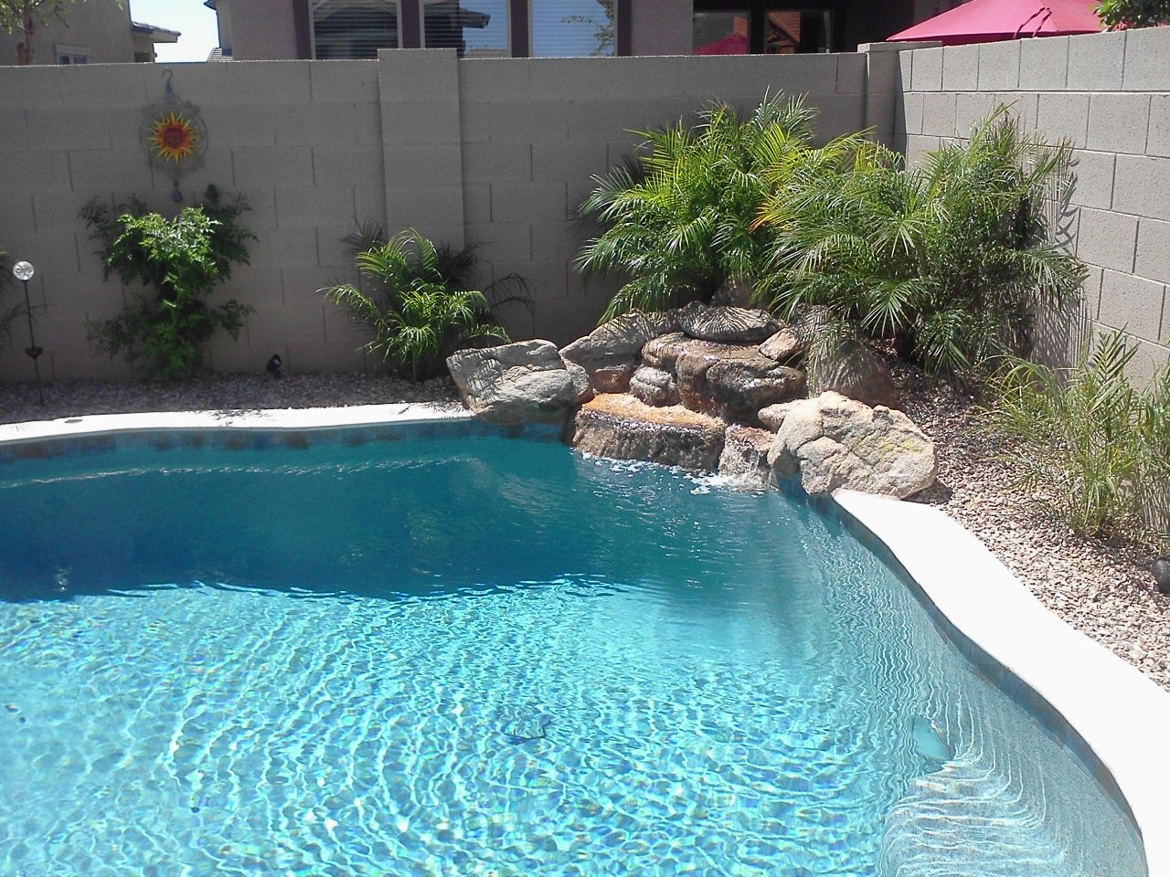 Nothing Makes Your Pool Pop Like A Unique Water Feature Description From Natlpools Co Inground Pool Landscaping Pool Water Features Pool Waterfall Landscaping