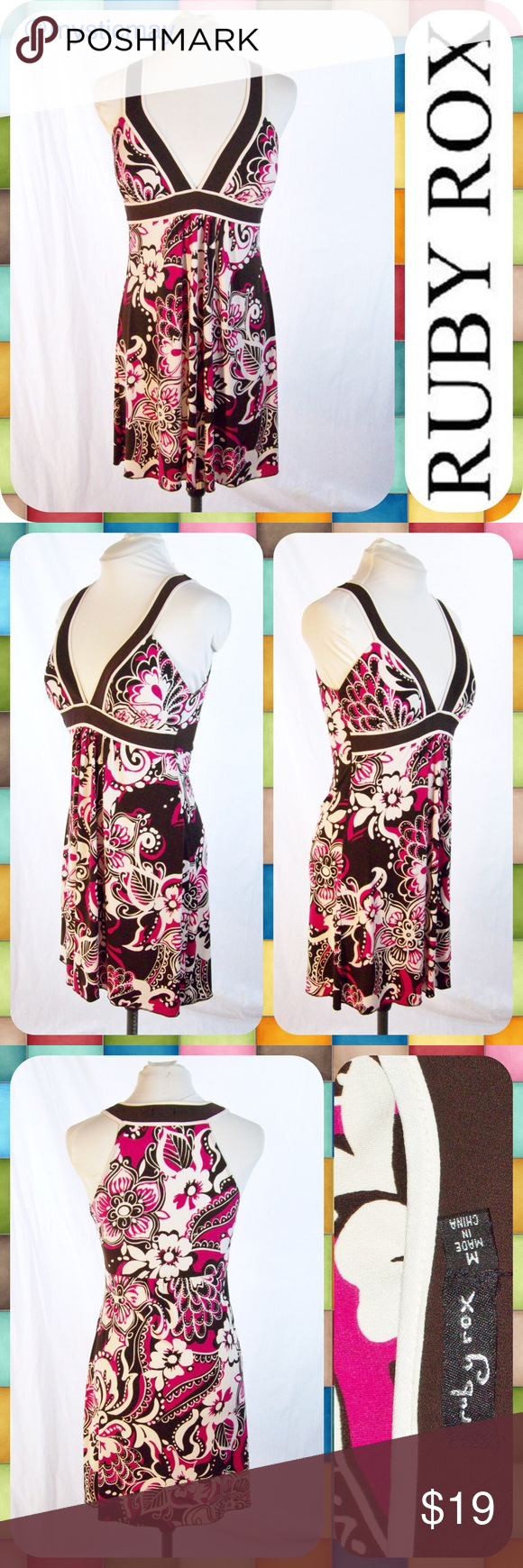 """RUBY ROX Magenta Floral Empire Waist Dress Size M Sleeveless jersey dress with a vibrant magenta floral print and plunging v-neckline. Empire waist with chocolate brown trim and lightly padded bust. Not lined. Juniors Size Medium (M) for ladies size 6/8. Measures 16"""" across the chest and 33"""" in length. A cute dress! Ruby Rox Dresses Midi"""