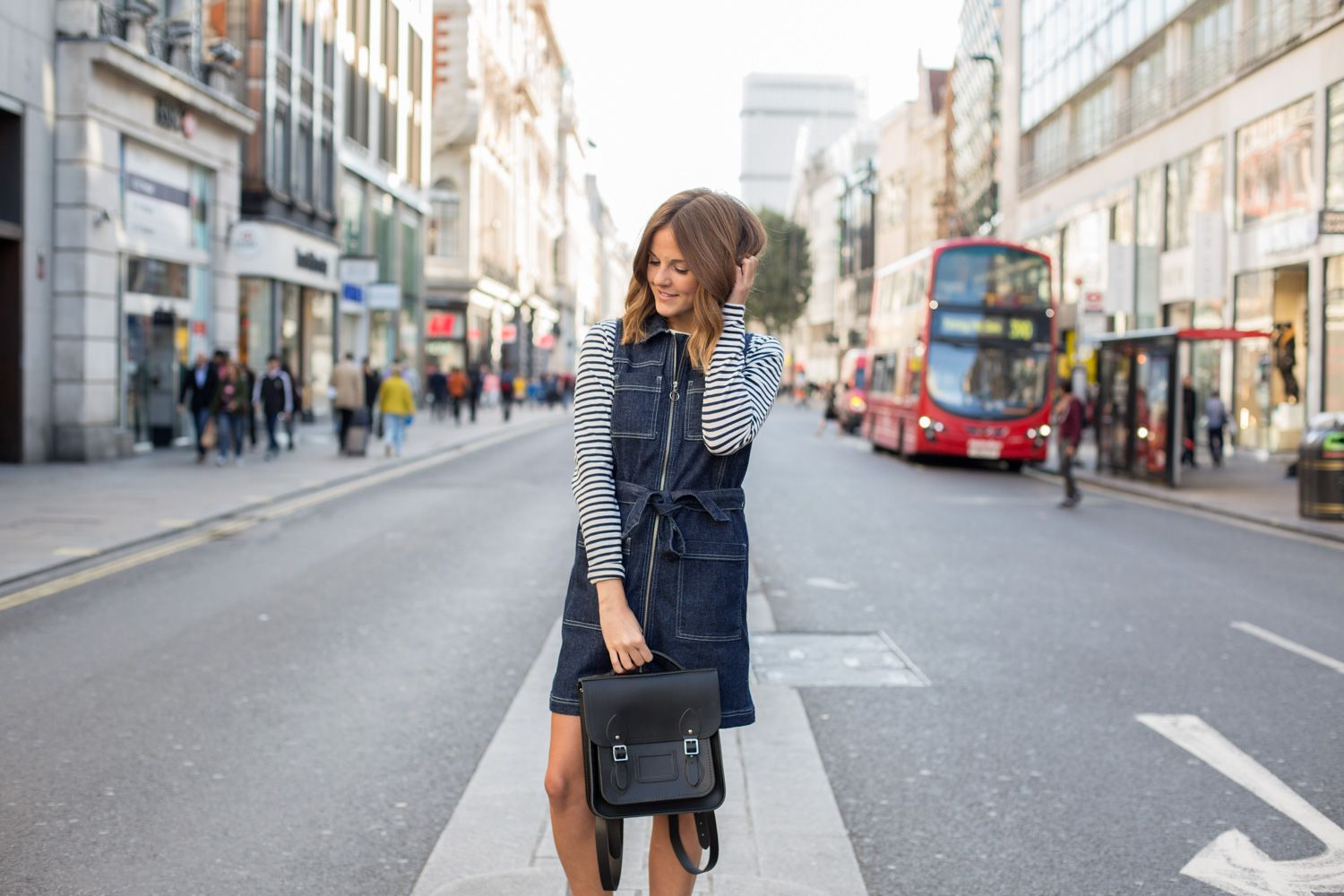 Kim from @LoveClothBlog wears our Small Portrait Backpack in Black.