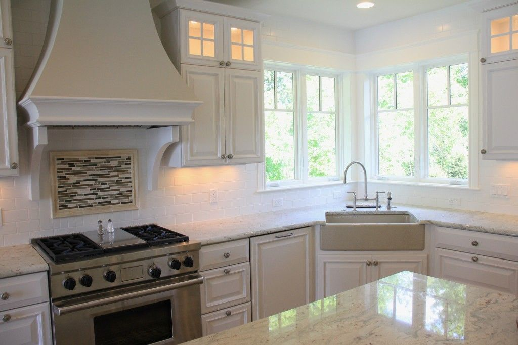 Lovely White classic kitchen with unique corner