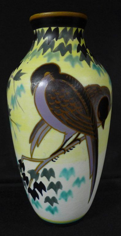 Art Deco vase depicting stylized birds in different attitudes resting on branches with leaves. Matte enamels on earthenware created at Atelier de Fantaisie by Charles Catteau and Jan Wind. Signed Boch Freres Keramis WD. 1637 and stamped with what looks like the number 806. French, circa 1932.