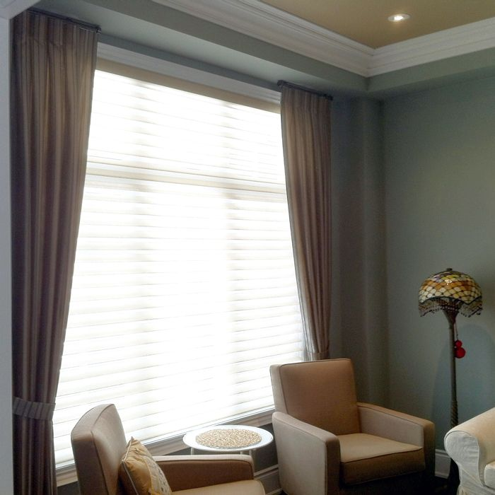 Adding Drape Side Panel Along With Silhouette Type Blinds On The Window Completes The Look Of The Living Room Blinds Home Decor Fabric Blinds