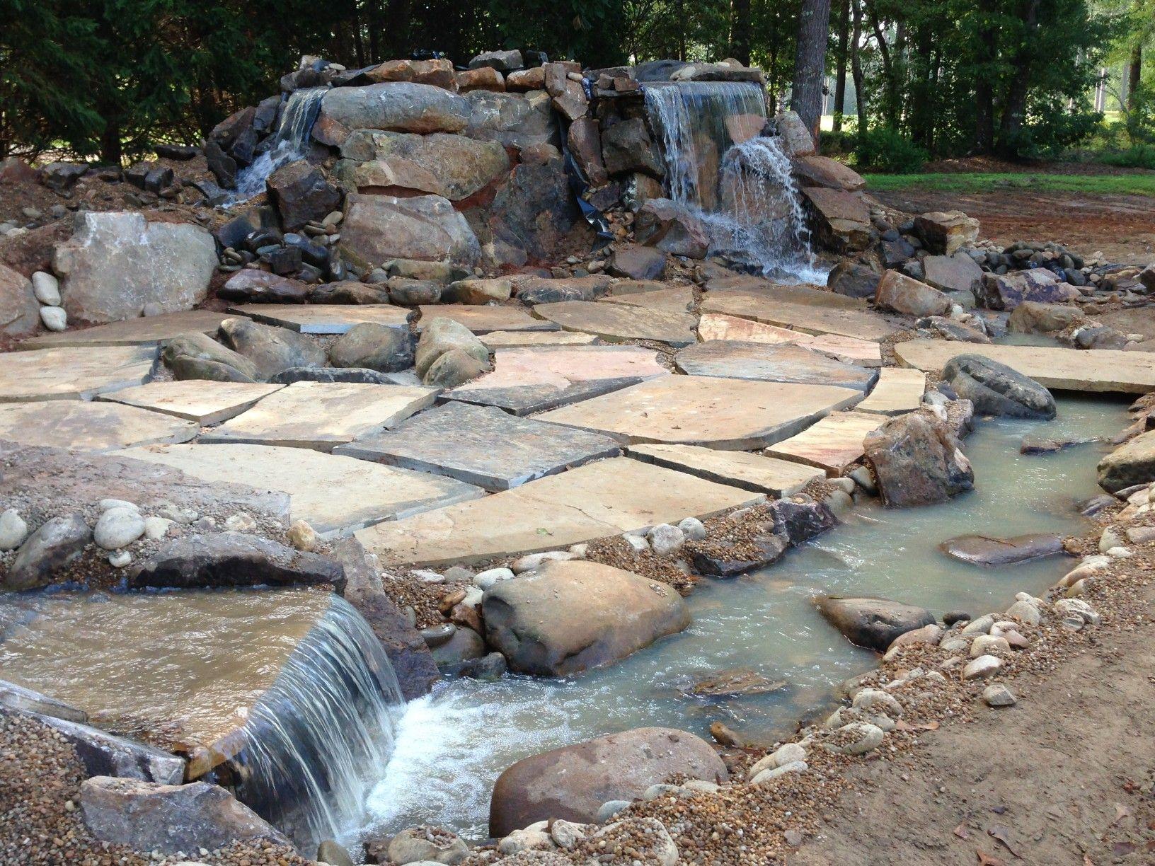 Backyard getaway Multiple waterfalls stream Mega flag stone patio