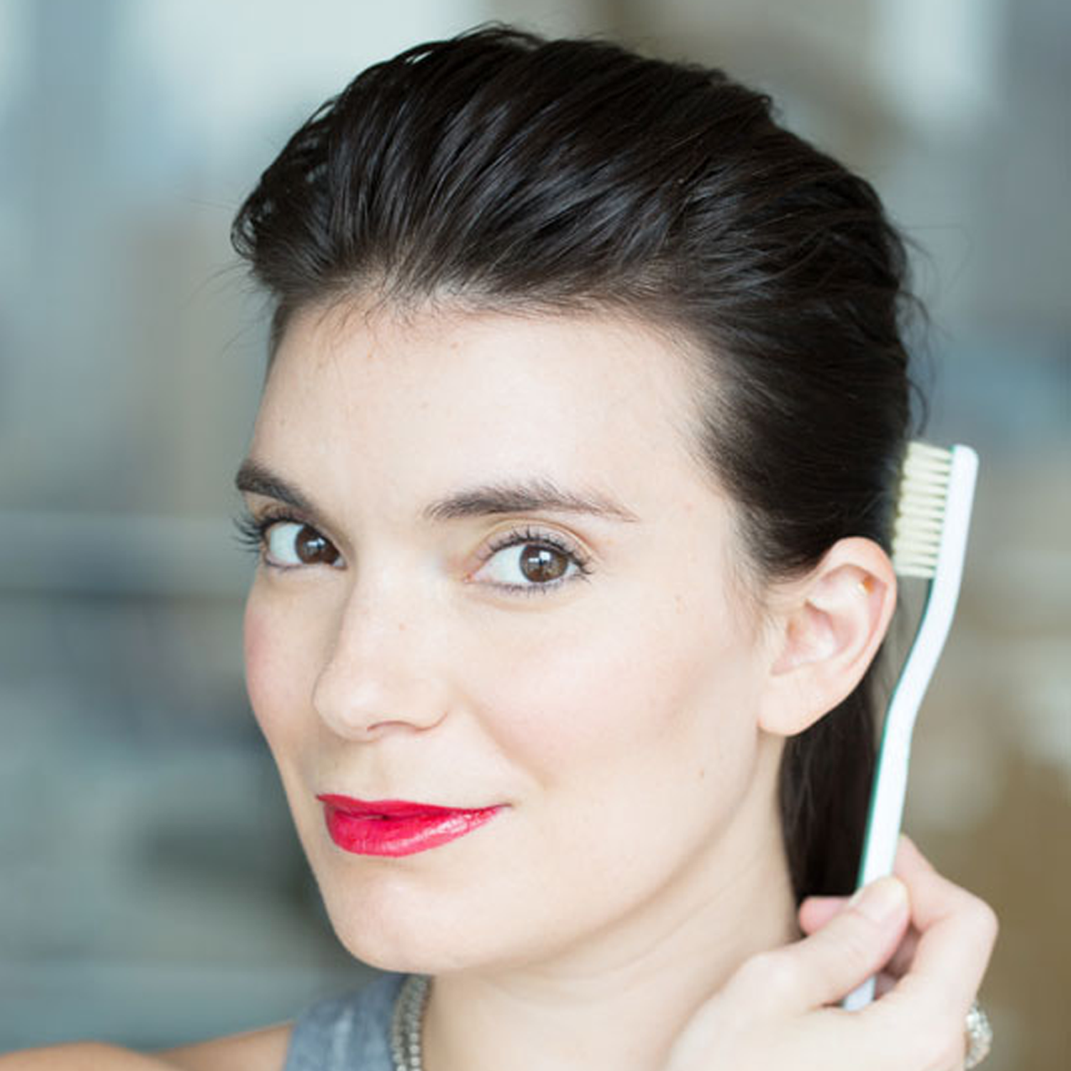 Tame flyaways, de-clump brows, and more beauty hacks to try with a toothbrush!