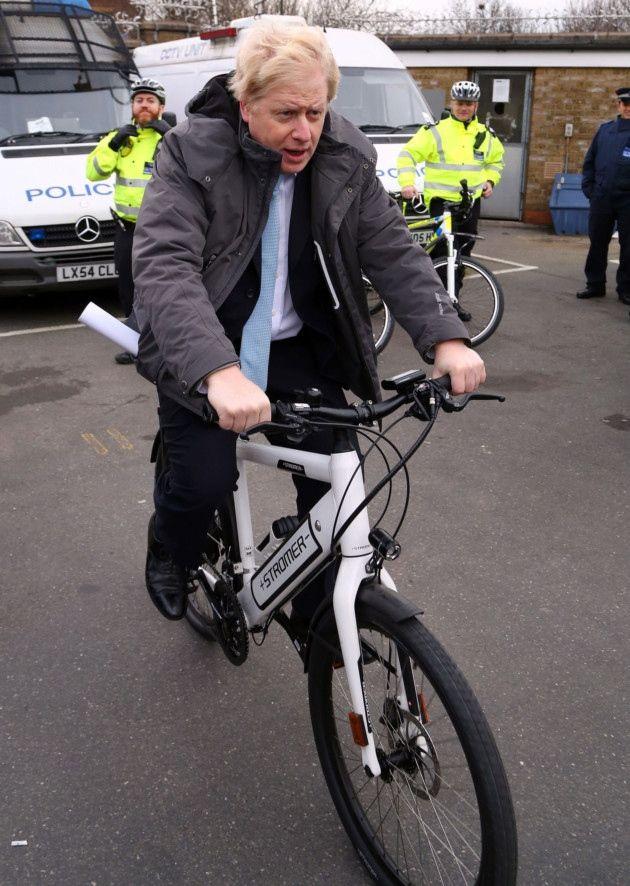 Mayor of London Boris Johnson tries an electric bike as he