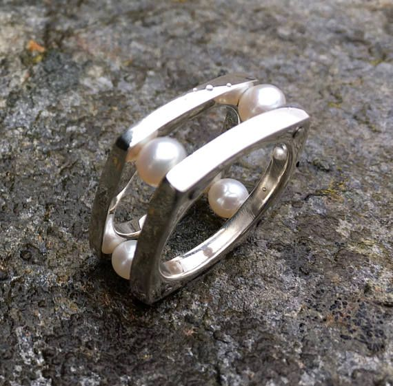 This ring is cast in sterling silver and riveted together displaying genuine pearls. Comfortable and unique, this lightweight statement ring will draw numerous compliments. Contact for sizing information. This ring is made to order, allow 2 to 3 weeks for production.