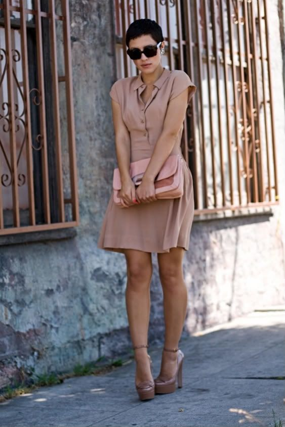 This fabulous nude dress is comfortable and cute for a sunny summer day. It is a shirt dress due to the buttons going down the front that mimic a button down shirt.