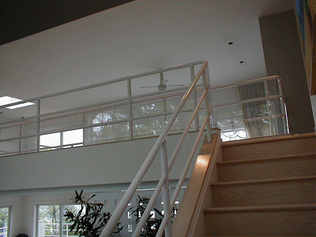 Plexiglass is used to protect wide gaps in railings, on