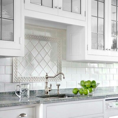 Subway Tile Backsplash With Pretty Insert Over Sink Backsplash